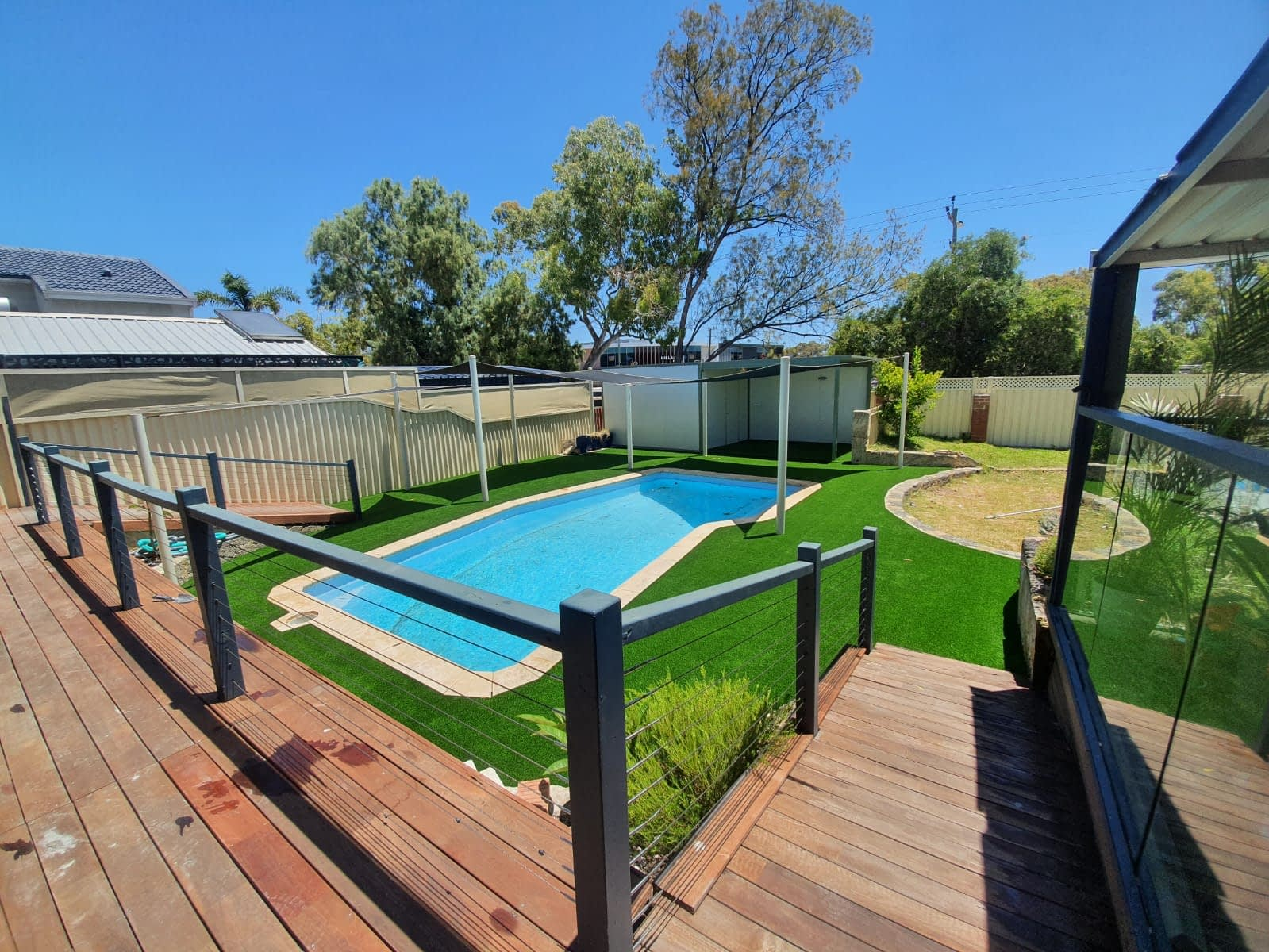 PAG - artificial grass installation around a pool 2