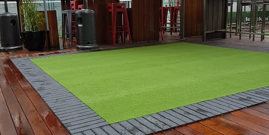 Backyard Golf Turf Installation in Roof Top Bar and Restaurant