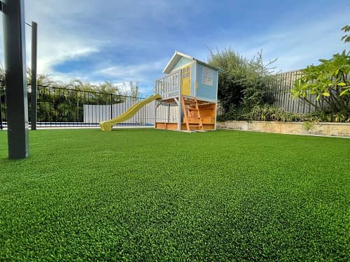 Synthetic Turf Installation Around a Cubby House