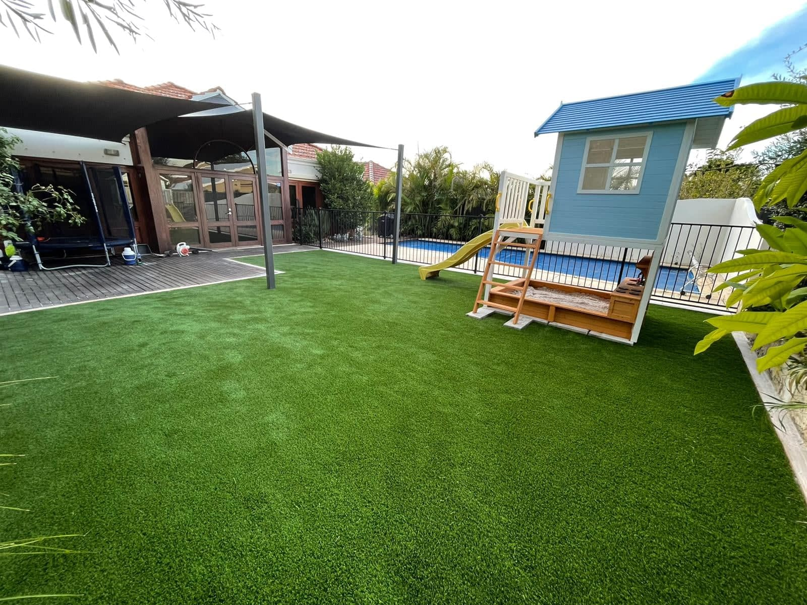 synthetic turf install cubby house 2