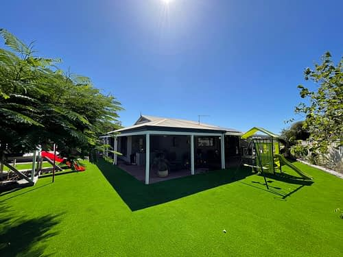 Beautiful Care Free Artificial Lawn For The Kids To Play On